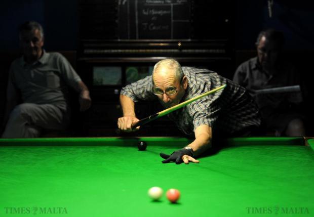 A snooker player takes a shot at the La Vallette Band club in Valletta on October 22. Photo: Chris Sant Fournier