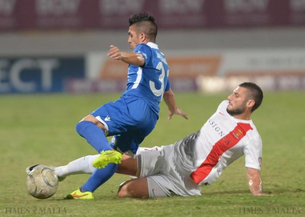 Valletta's Ryan Camilleri (right) steals the ball from Pieta's Claudio Frances during their Premier league match at the Ta'Qali National Stadium on October 2. Photo: Matthew Mirabelli