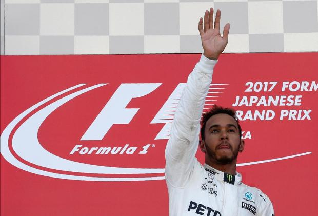 Mercedes' Lewis Hamilton of Britain waves after winning the race.