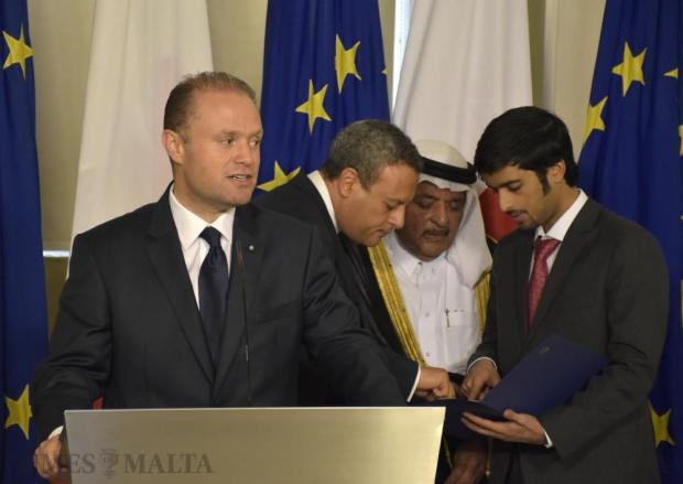 Prime Minister Joseph Muscat addresses the media while Sheikh Faisal consults with two aides during a press conference to announce that Banif Bank Portugal was selling its majority stake in Banif Bank Malta to a private Qatari investment group, at Auberge de Castille in Valletta on October 5. Photo: Mark Zammit Cordina