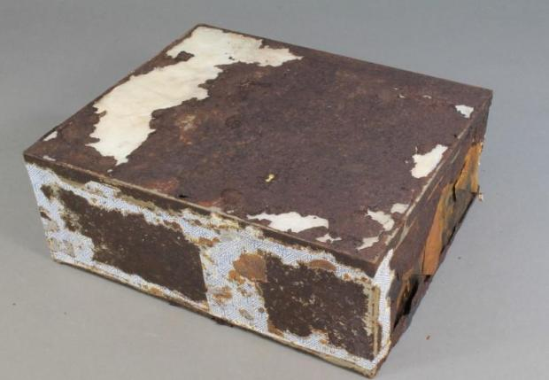 While its tin was rusted, the cake inside seemed fine. Photo: Antarctic Heritage Trust