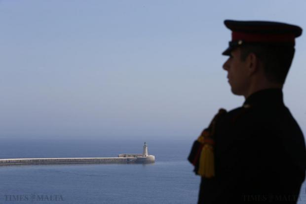 An Armed Forces of Malta bugler stands at attention during a commemoration service in remembrance of those who lost their lives during World War II at the Siege Bell Memorial overlooking Grand Harbour in Valletta on April 15. The service was held to commemorate the 73rd anniversary of Britain's King George VI's proclamation on April 15, 1942, awarding Malta the George Cross for its sacrifice in World War II. Photo: Darrin Zammit Lupi