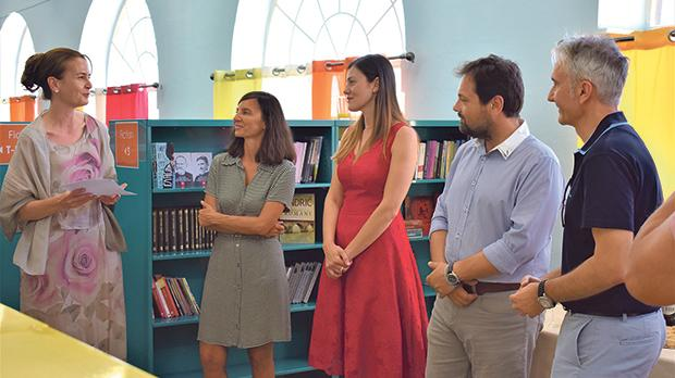 Duška Malešević (left) presenting the books to Cheryl Falzon (third from left) in the presence of other officials.