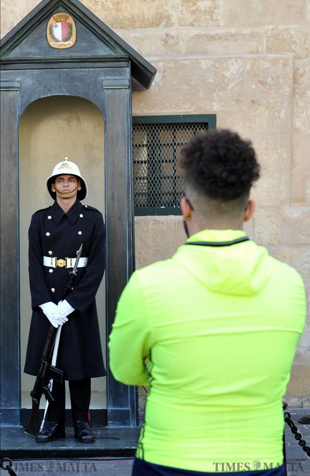 A tourist looks at a Palace Guard in Valletta on March 1. Photo: Chris Sant Fournier