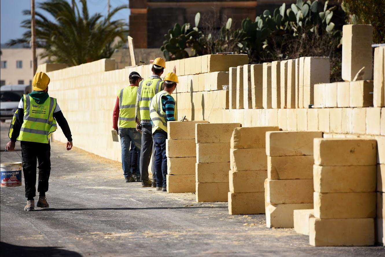 Workers in Attard. IMF analysts warned that infrastructural investment would need to be adequately managed as it increased.