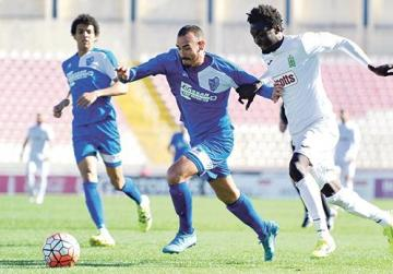Tarxien's Matthew Tabone (left) tries to keep Amadou Samb, of Floriana, off the ball during Saturday's Premier League match. The Greens won 1-0.