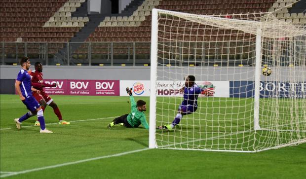 Haruna Garba (left) scores Gżira United's first goal against St Andrews. Photo: Mark Zammit Cordina
