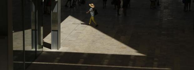 A woman walks past Parliament House in Valletta on July 18. Photo: Darrin Zammit Lupi
