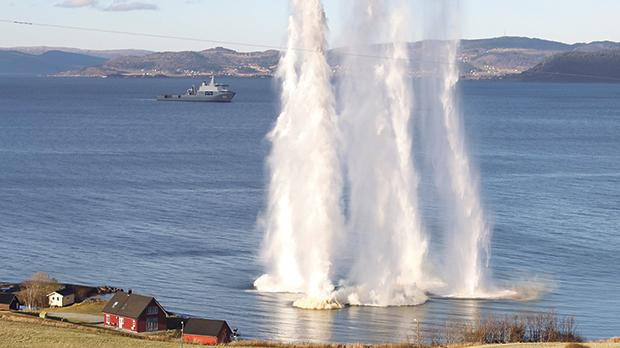 Water shoots upward from blasts during Nato's Exercise Trident Juncture.