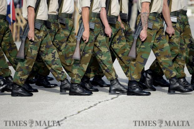 Soldiers march during the passing out parade for new recruits on October 16. Photo: Mark Zammit Cordina