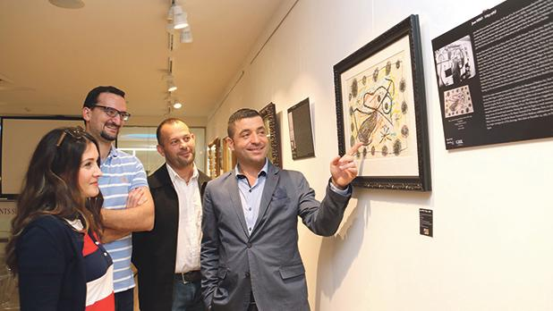 Art critic Charlene Vella, Christian Zammit, artist Chris Saliba and Valerio Ballotta viewing the exhibition. Photos: Charles Spiteri