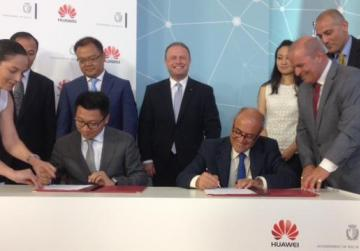 The signing of the agreement with Huawei Technologies. Photo: Matthew Mirabelli