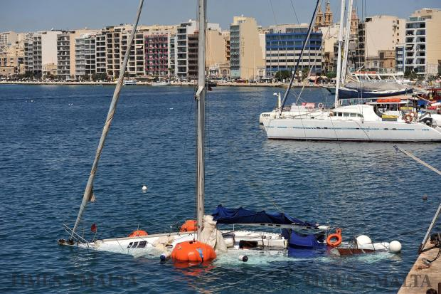 A sailing yacht is being brought back to the surface with air bags on August 10, after sinking at its mooring the day before. Photo: Chris Sant Fournier