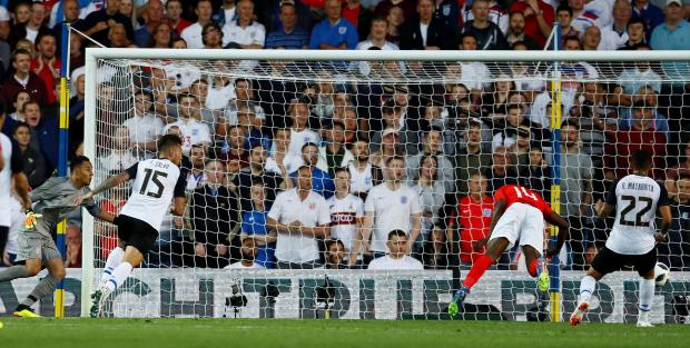 England's Danny Welbeck scores their second goal.