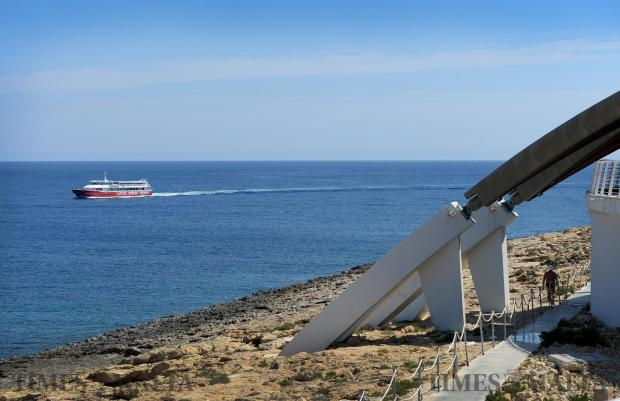 A pleasure cruise boat passes by the Aquarium in Qawra on May 19. Photo: Matthew Mirabelli