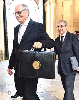 A few million light? Finance Minister Edward Scicluna brandishing the famous budget bag. Photo: Chris Sant Fournier