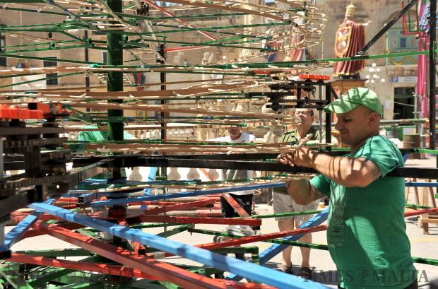 A man assembles a Catherine wheel before the feast of St Philip in Zebbug on June 15. Photo: Chris Sant Fournier