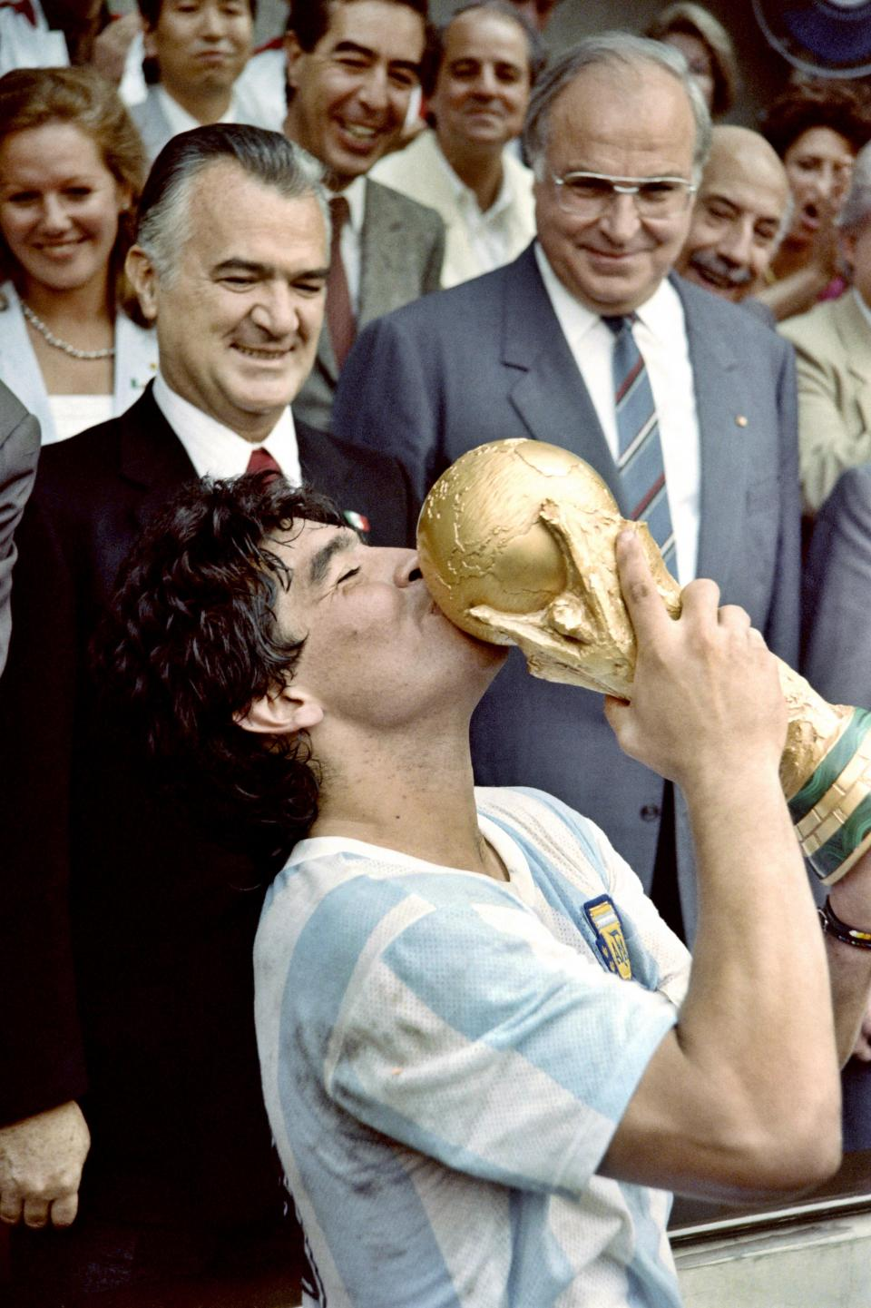Maradona kisses the 1986 World Cup: the victory was arguably the pinnacle of his footballing career. Photo: AFP