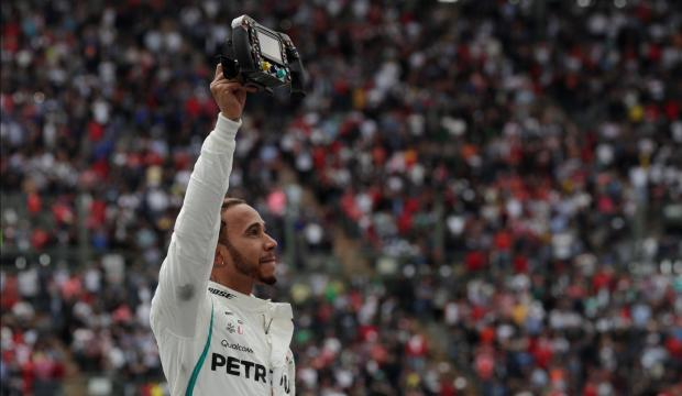 Mercedes' Lewis Hamilton celebrates after winning the World Championship.