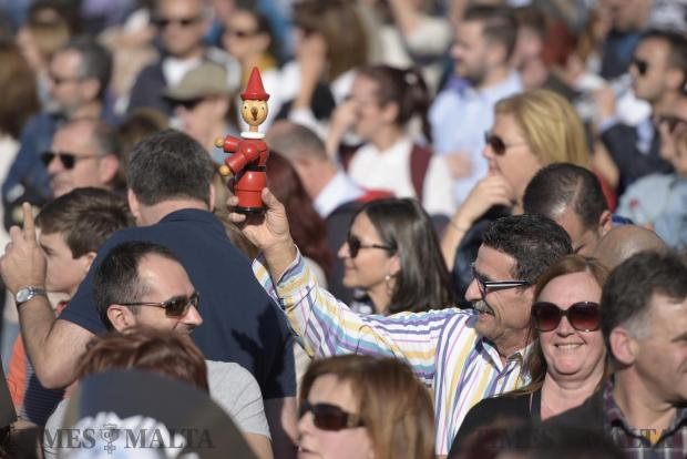 A man holds up a toy figure of cartoon character Pinocchio during an anti-corruption protest in Valletta on April 23. Photo: Mark Zammit Cordina