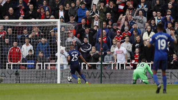 Manchester United's Antonio Valencia scores their third goal.