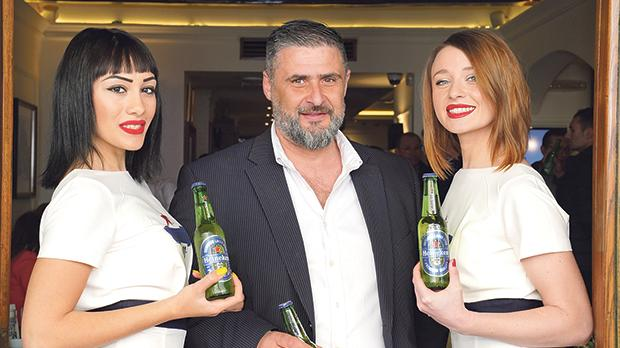 Darren Vassallo, operations manager at Charles Grech, with hosts at the event.