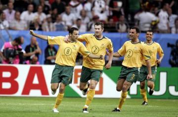 Josip Skoko celebrates scoring the first goal for Australia with Brett Emerton and Kevin Muscat (no.2).