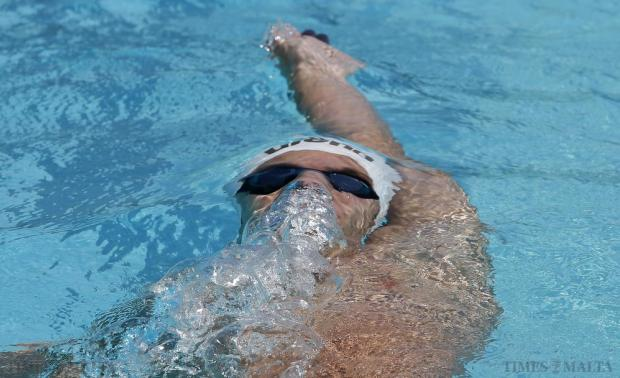 A swimmer competes in the backstroke event during the ASA National Swimming Championships at the National Pool in Tal-Qroqq on June 28. Photo: Darrin Zammit Lupi