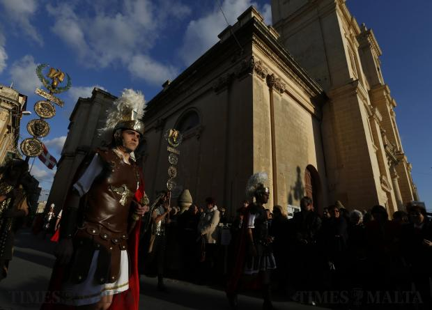 Participants dressed as Roman soldiers march past St Philip Church during a Good Friday procession in Zebbug on March 25. Photo: Darrin Zammit Lupi