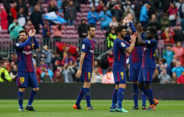 Barcelona players celebrate after the match.