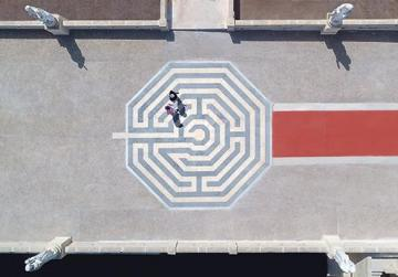 The labyrinth-patterned mosaic at the entrance to the parvis of Ta' Pinu church at Għarb.
