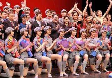 North Korea's Kim pirouettes from missiles to ballet