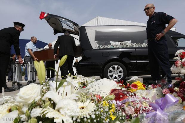 Hospital workers put a coffin with the body of a migrant into a hearse after an inter-faith burial service for 24 migrants at Mater Dei Hospital in Tal-Qroqq on April 23. An imam and a bishop led a poignant inter-faith funeral service for 24 drowned migrants, the only victims whose bodies were recovered from the Mediterranean in the weekend shipwreck that shocked Europe. The dead were picked up by the Italian vessel Gregoretti and brought to Malta after their vessel capsized and sank. As many as 900 people are believed to have died. Photo: Darrin Zammit Lupi