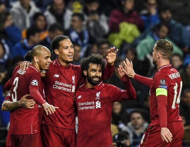 Liverpool players celebrate their victory over Porto.