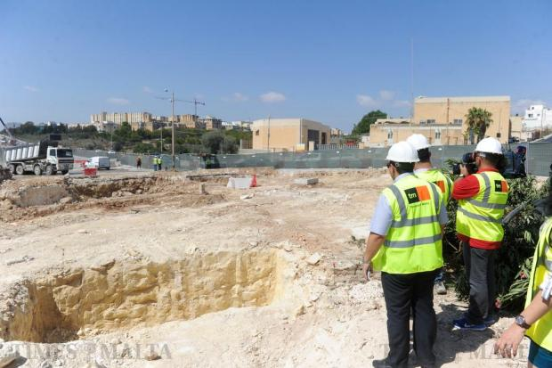 Transport Malta officials look on as works are carried out at the Kappara junction on August 12. Photo: Steve Zammit Lupi