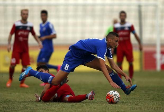 Mosta's Kyle Frendo stretches while controlling the ball during a challenge from Pembroke's Gustavo Villalobos (partly hidden) during their Premier League football match at the National Stadium in Ta'Qali on October 24. Photo: Darrin Zammit Lupi