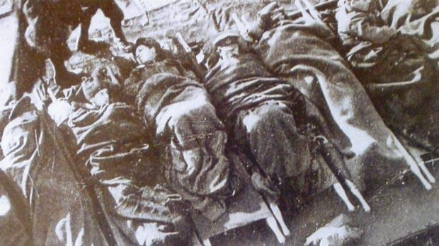 Wounded soldiers at the Salonika front on a raft being taken to a hospital ship.