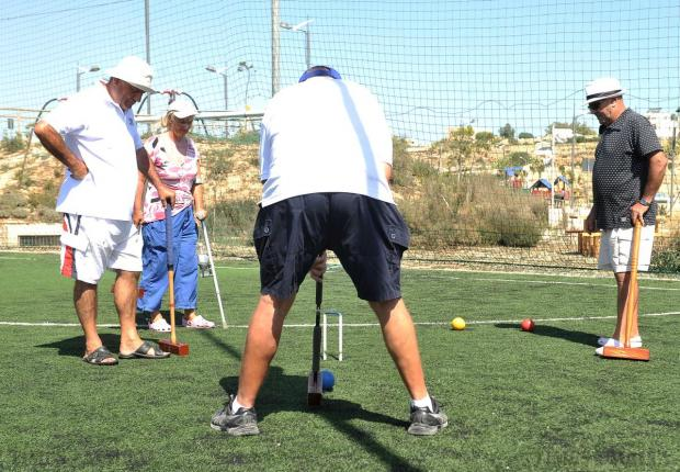 Members of the Marsascala Croquet Club enjoy a game of croquet at the Family Park in Marsascala on August 25. Photo: Chris Sant Fournier