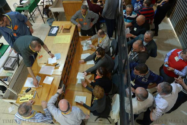 Party agents pictured behind a perspex screen watch as the sorting of votes in the Local Council elections gets under way at Naxxar on April 18. Photo: Matthew Mirabelli