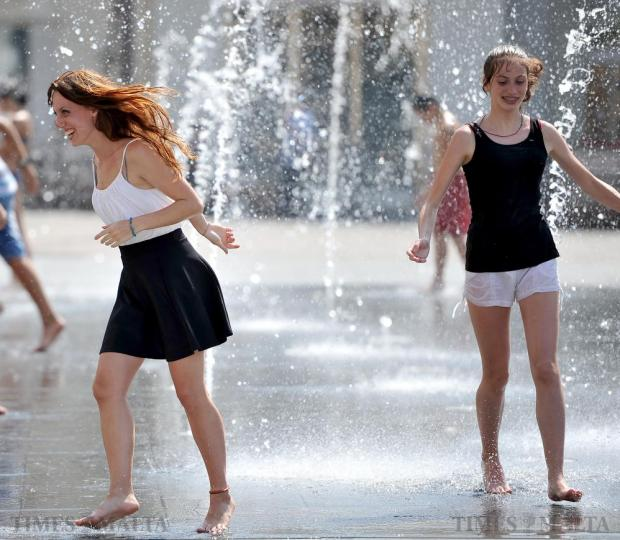 Tourists cool off in the fountains at St George's Square in Valletta on July 9. Photo: Chris Sant Fournier