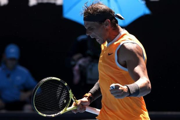 Spain's Rafael Nadal celebrates winning the match against Australia's James Duckworth.