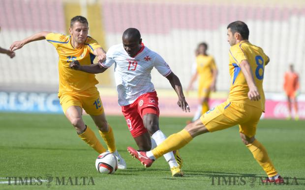 Malta's Alfred Effiong (centre) tries to make his way past Moldova's Adrian Cascaval (left) and Alexandru Gatcan during an International friendly match at the National Stadium in Ta'Qali on March 24. Photo: Matthew Mirabelli