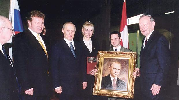 Babailov's portrait of Russian President Vladimir Putin being presented to him.