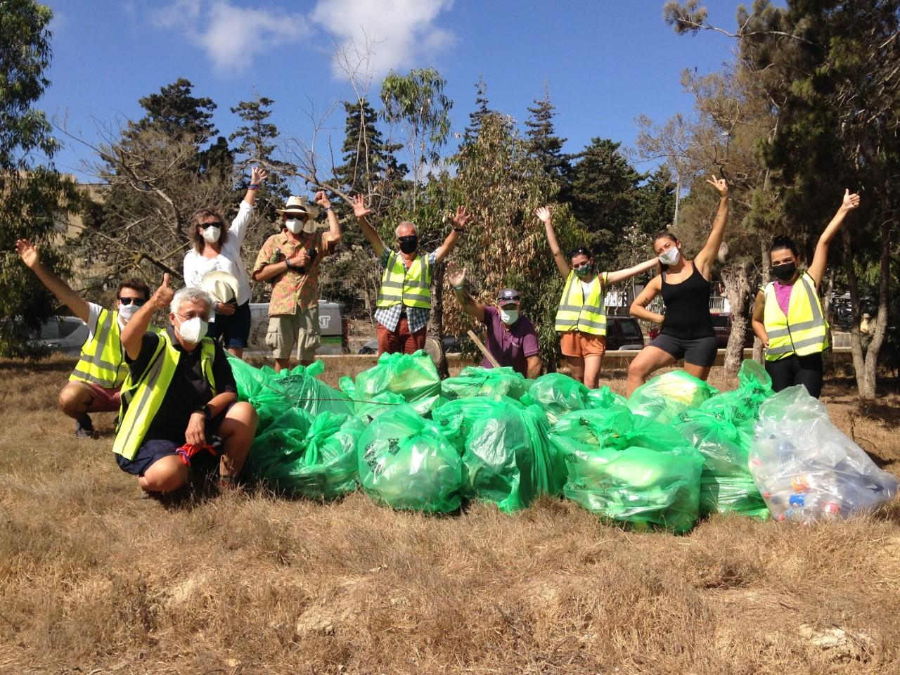 A group of volunteers after a rubbish collection campaign in Ulysses Grove, Xewkija.