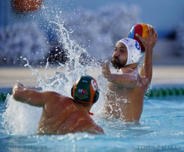Marsaxlokk's Ivan Vuksanovic (right) attempts a shot on goal as Marsascala's Liam Grixti tries to block during their First Division waterpolo match at the National Pool in Tal'Qroqq on August 19. Photo: Darrin Zammit Lupi