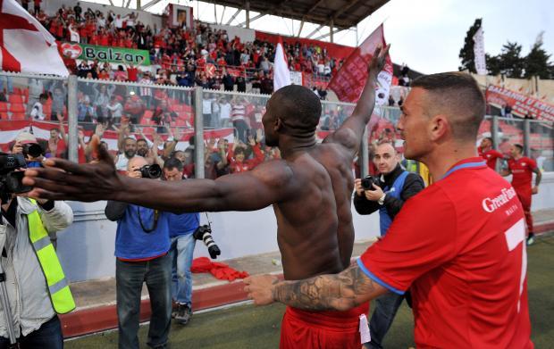 Man of the match Effiong celebrates with Balzan's fans. Photo: Chris Sant Fournier