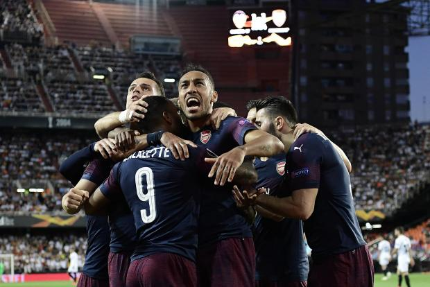 Arsenal's Gabonese striker Pierre-Emerick Aubameyang (centre) celebrates with teammates after scoring a goal during the UEFA Europa League semi-final.