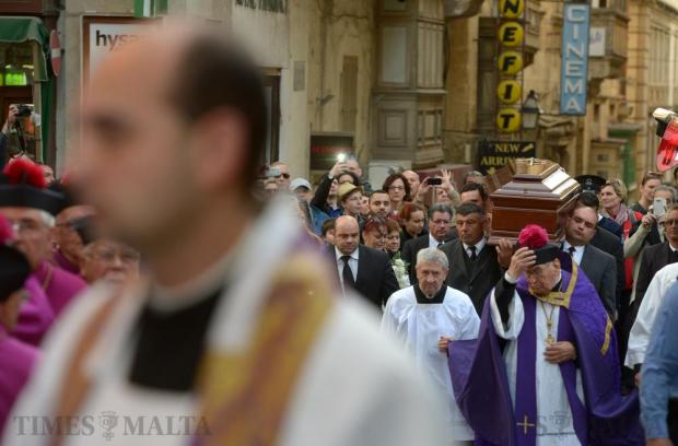 Members of the clergy participates in the cortege as the body of Archbishop Emeritus Joseph Mercieca is carried to St John's Co-Cathedral in Valletta on March 21. The 87-year-old former archbishop passed away earlier in the day. Photo: Matthew Mirabelli