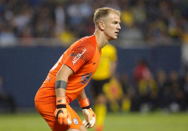 Joe Hart has completed his move to Burnley.