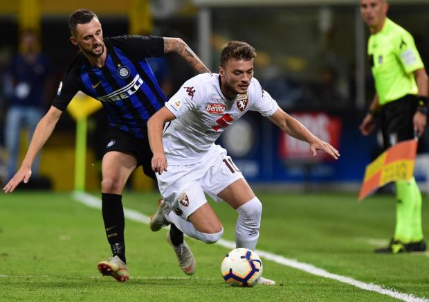 Torino's Serbian forward Adem Ljajic (Front) outruns Inter Milan's Croatian midfielder Marcelo Brozovic.